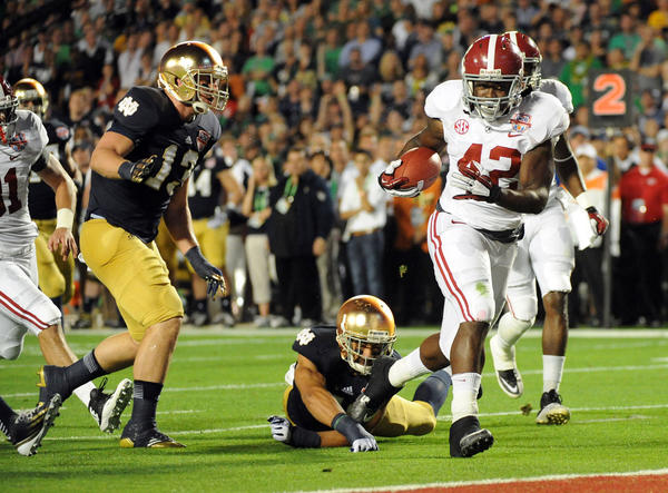 Eddie Lacy of Alabama scores a touchdown in the first quarter against Notre Dame to put Alabama ahead 7-0. 2013 Discover BCS Championship Game. University of Alabama vs. Notre Dame.