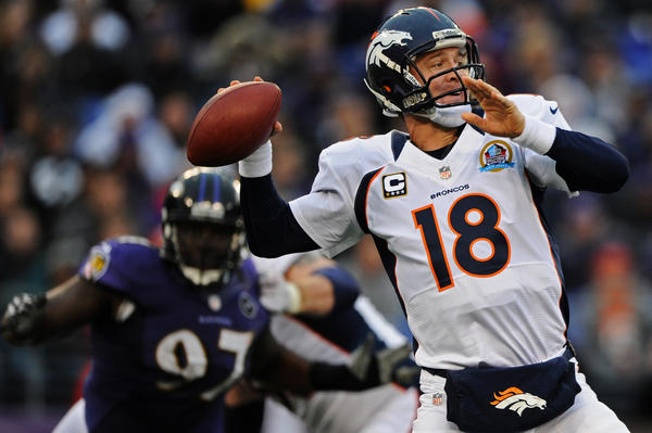 Peyton Manning prepares to pass in game against the Ravens in December.