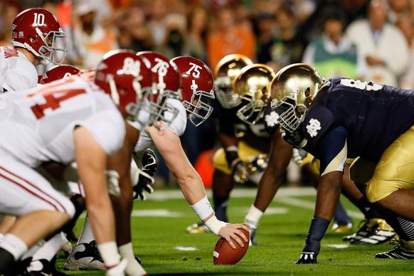 Alabama quarterback AJ McCarron (10) lines up under his center Barrett Jones (75) against the Notre Dame Fighting Irish in the first quarter of the BCS title game.