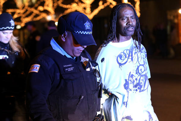 Jimmy Harris, 56, is taken into custody by Chicago Police.