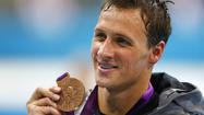 Ryan Lochte holds his bronze medal during the men's 200m backstroke victory ceremony during the London 2012 Olympic Games