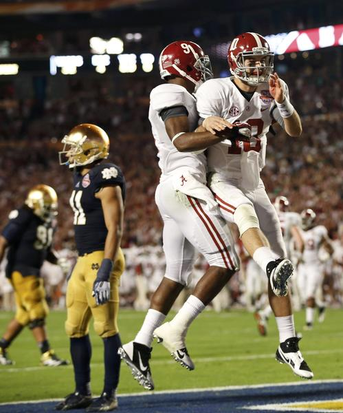 Alabama quarterback AJ McCarron (right) celebrates with wide receiver Amari Cooper after they connected for a touchdown against Notre Dame in the BCS National Championship game Monday.