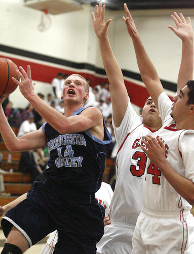 Crescenta Valley's Cole Currie takes a shot against against Glendale's Arthur Terzyan and Daryoush Rahimi at Glendale High School in a Pacific League boys basketball game at on Monday, January 7, 2013.