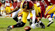 WASHINGTON — The season is over for the Washington Redskins, but the controversy continued to boil Monday over Coach Mike Shanahan's decision to keep rookie quarterback Robert Griffin III in a playoff game against Seattle despite an obviously weakened right knee that ultimately buckled.