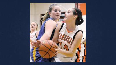 Shanksville's Karianne Sulkowski (left) pressures Somerset's Jay Martin under the basket in girls high school basketball action Monday night.