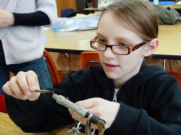 Shelby Brazes, 10, of Walnutport, ties her first fly during the opening session of the 2013 fly tying class held by the Hokendauqua Chapter of Trout Unlimited last week. The class runs 9:30-11:30 a.m. Saturdays through Feb. 23.