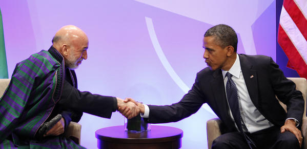 President Obama shakes hands with Afghanistan's President Hamid Karzai at the NATO Summit in Chicago, May 20, 2012.