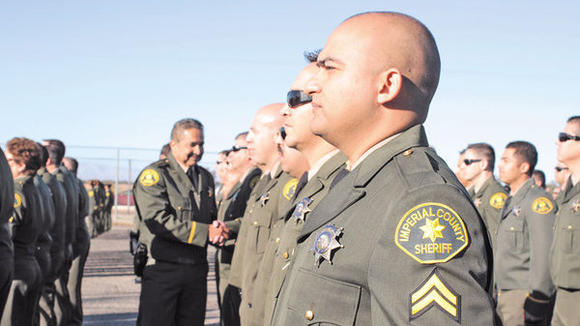 Imperial County Sheriff Raymond Loera inspects local Sheriff's Office staff