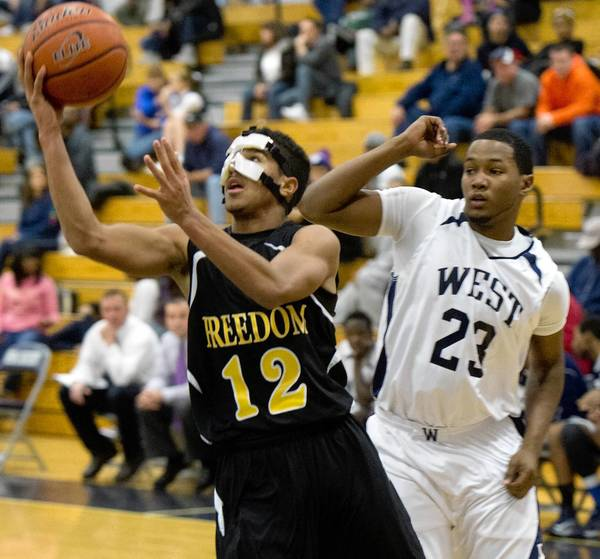 Freedom's Maceo Connor (12) shoots in front of Pocono Mountain West's Marquis Diaz.
