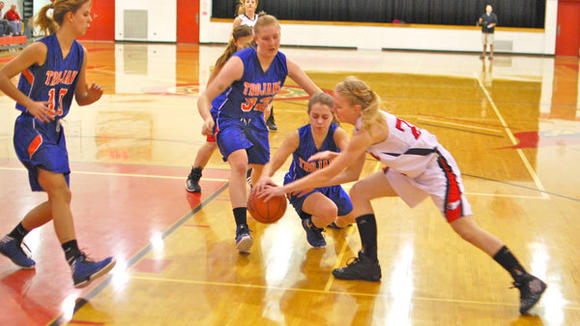J-L JUNIOR McKENZIE MATHEWSON hunts for the ball during the Cardinals' win against Central Lake Monday.