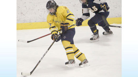 GAYLORD SOPHOMORE FORWARD Mitchell Lawton brings the puck up the ice against Cadillac. The Blue Devils lost to the Vikings by a goal Friday.