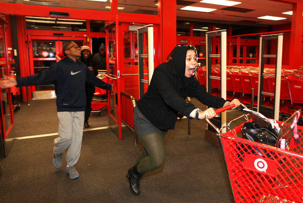 Target said its policy of matching the prices of select online retailers will now be year-round. Above, Target shoppers in Chesapeake, Va., get a jump on Black Friday on Thanksgiving night.