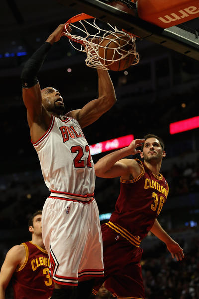 Taj Gibson #22 of the Chicago Bulls dunks over Omir Casspi #36 of the Cleveland Cavaliers at the United Center on January 7, 2013 in Chicago, Illinois.