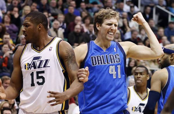 Dallas Mavericks forward Dirk Nowitzki (41) reacts to a call against Utah Jazz forward Derrick Favors (15) during the second half of their NBA basketball game in Salt Lake City Utah, January 7, 2013.