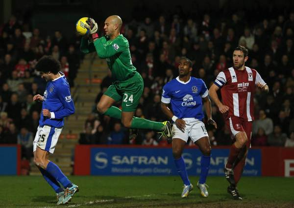 Goalkeeper Tim Howard of Everton catches a cross from Cheltenham Town during their FA Cup third round soccer match at the Abbey Business Stadium in Cheltenham, January 7, 2013.