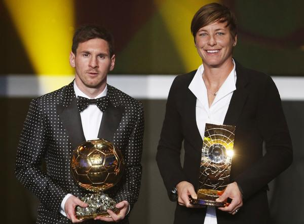 Lionel Messi of Argentina, FIFA World Player of the Year 2012 (L) poses with FIFA Women's World Player of the Year 2012 Abby Wambach of the U.S., during the FIFA Ballon d'Or 2012 soccer awards ceremony at the Kongresshaus in Zurich January 7, 2013.