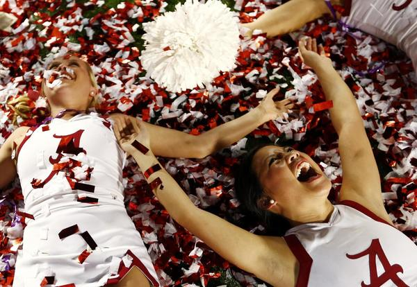 Alabama Crimson Tide cheerleaders celebrate after Alabama defeated the Notre Dame Fighting Irish in their NCAA BCS National Championship college football game in Miami, Florida, January 7, 2013.