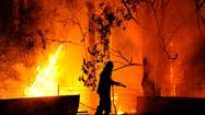 Scores of fires continued to rage across southeastern Australia on Tuesday as the country sizzled under scorching heat. More than a dozen were still burning out of control late in the day, as firefighters battled to squelch flames sweeping through dry grasses and scrubland in New South Wales.
