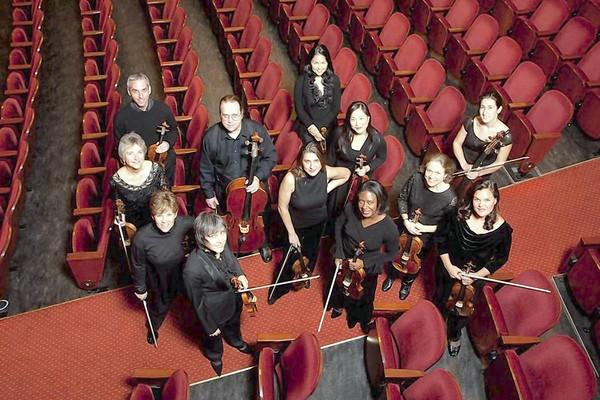 New Century Orchestra directed by Nadja Salerno-Sonnenberg (pictured in middle of group, below).