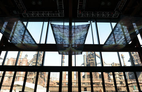 This is one of three murals that is part of Mike and Jamie Cabreza's exhibit, Blast Furnace, at the ArtsQuest Center at SteelStacks. It consists of 32 photos printed on aluminum of the molten steel attached to 16 blocks that are arranged into seating configurations.