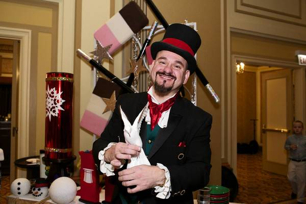 The Great Frankini, whose real name is Frank Glab, poses with a dove during the Joffrey Ballet's Nutcracker Family Dinner at the Palmer House on Saturday, Dec. 15, 2012, in Chicago.