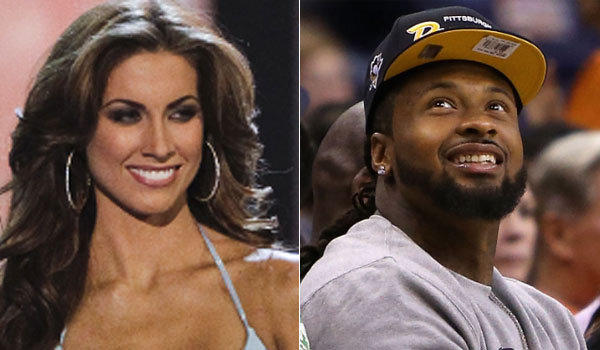 Arizona Cardinals defensive end Darnell Dockett, right, tweeted his phone number to Katherine Webb while her boyfriend, Alabama quarterback AJ McCarron, was playing in the BCS title game.