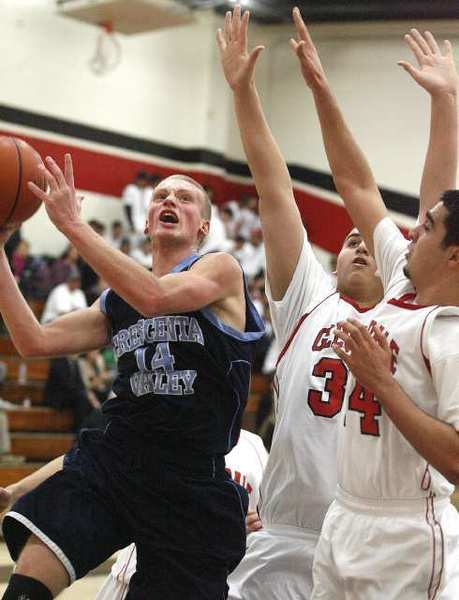 Crescenta Valley's senior guard Cole Currie, left, finished with 34 points to help the Falcons improve to 2-0 in the Pacific League.