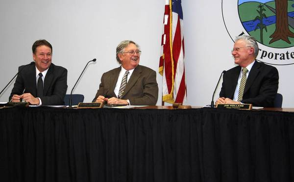 Frankfort Trustees Todd Morgan, right, and Dick Trevarthan share a laugh with Mayor Jim Holland during the Jan. 7 Village Board meeting. Trustees voted to transfer six acres to the Frankfort Park District.