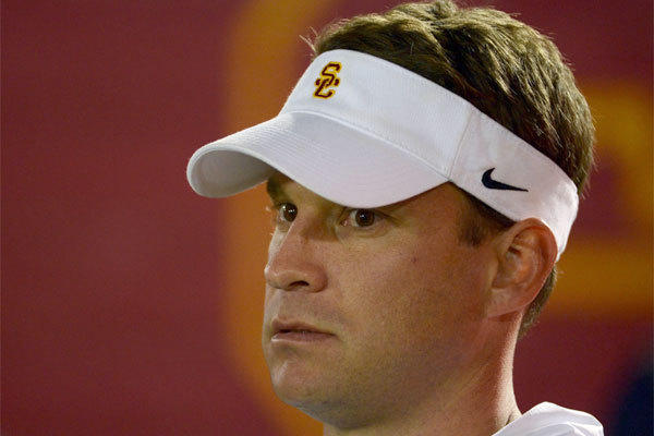 USC Coach Lane Kiffin watched the BCS title game from his office instead of the sideline in Miami, where many people predicted the Trojans would end up at the beginning of the season.