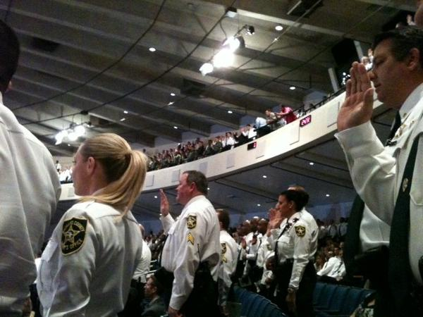 Broward Sheriff deputies take the oath by newly elected BSO Sheriff Scott Israel at the Faith Center in Sunrise.
