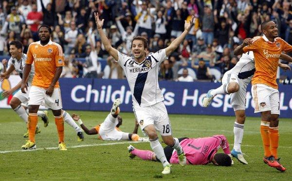 Mike Magee signed to play another season for the Galaxy.