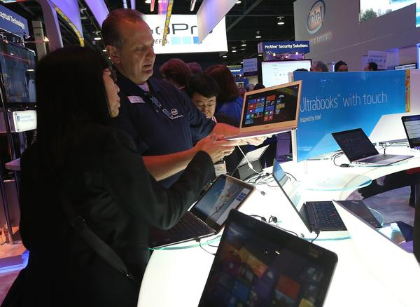 Attendees inspect Intel UltraBooks.