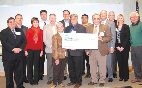 Family and associates of Kenneth E. Lutz gathered recently as a scholarship was named in his honor. From left, Sean Lutz, Robert Mazzei, Kerri Hesley, Kevin McCarthy, Allan Wexler, Elaine Lutz, Greg Zimmermann, Paul Marinelli, Narasim Murthy, Hagerstown Community College President Guy Altieri, HCC Trustee Austin Abraham, HCC Trustee John Williamson, Stacey Lowman, HCC executive director of college advancement, and Edward Lampton.
