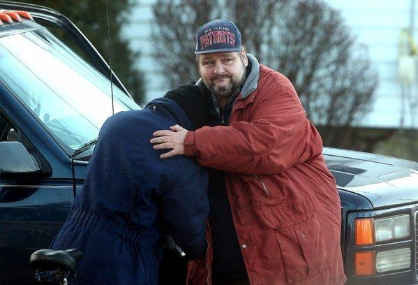 Clyde Schimanski Jr., right, gets a hug from a friend as a recovery effort resumed for two teenagers, one of them Schimanski's son, who are thought to have fallen through the ice into Budd Lake in Mount Olive Township, N.J. A body was pulled from the lake Tuesday.