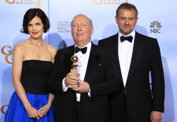 "Writer-producer Julian Fellowes (C) from ""Downton Abbey,"" winner of best mini-series or motion picture made for TV, poses with his award with actors Elizabeth McGovern and Hugh Bonneville."