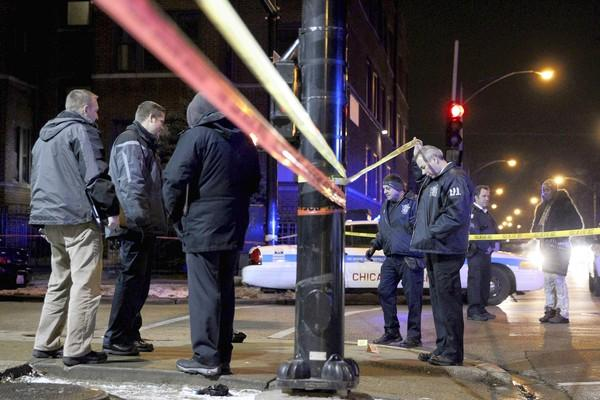 Chicago police investigate a slaying in December. There were 506 homicides in the city in 2012. New York had 418.