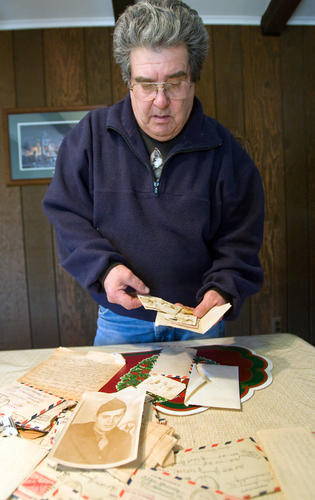 John Yawney, of Hanover Township, holds one of the many letters sent by his grandmother in her search for her son, Will Yawney, during WW II on Tuesday. Will's remains were recently found on the Island of Saipan and will be returned to the family this spring. The family has been searching for his remains and whereabouts since he went missing somewhere around July 7th, 1944. The family received many conflicting reports of his status in the years following the war and is relieved to finally have some closure.