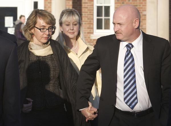 Former U.S. Rep. Gabrielle Giffords and her husband, former astronaut Mark Kelly, leave the Newtown Municipal Building in Newtown on Jan. 4.