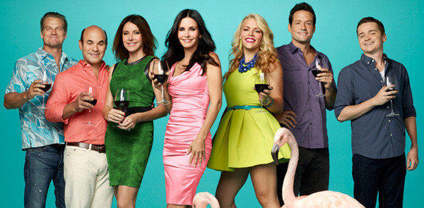 "Courteney Cox (center) and the cast of ""Cougar Town."""