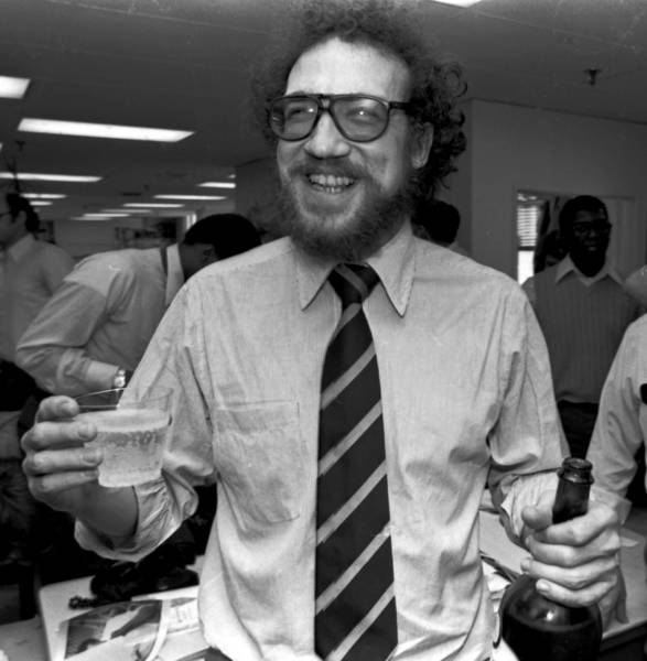 Richard Ben Cramer celebrates his Pulitzer win for international reporting in 1979 with colleagues in the Philadelphia Inquirer newsroom.