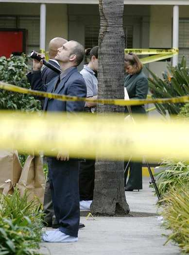 Forensic investigators with the Glendale Police Department gather evidence from the courtyard at 125 East Glenoaks Blvd. where there was a shooting on Monday, January 7, 2013.