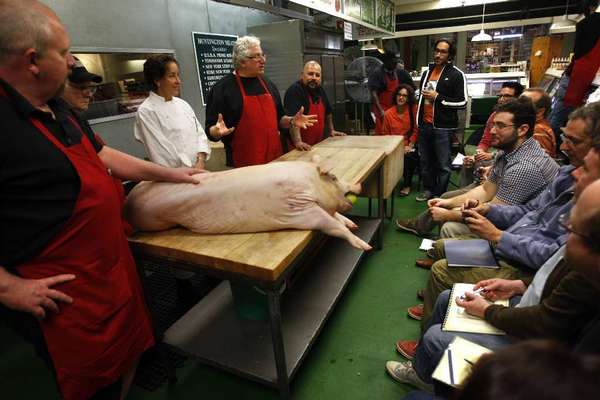 Butcher Bob Ore, from left, Dan Vance, Jar chef Suzanne Tracht, Jim Cascone and butcher John Escobedo conduct a meat cutting and cooking class at Huntington Meats.