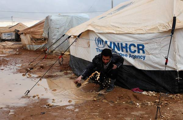 A Syrian refugee is among those whose tents were flooded at the Zaatari camp in Jordan.