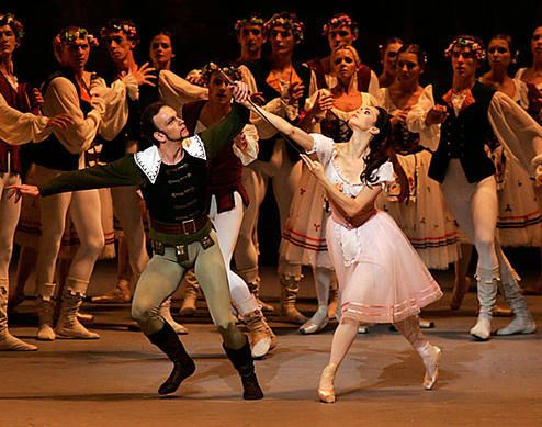 "Diana Vishneva as Giselle dances with Dmitry Pykhachev as Hans, a woodsman, in the  Kirov Ballet's production of the classic ""Giselle."""