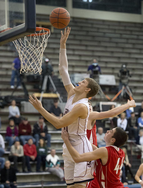 Liberty High School's Greg Noack puts up a basket as he is guarded by Parkland High School's Alexander Mitton during Lehigh Valley Conference boys basketball game in Bethlehem on Tuesday.