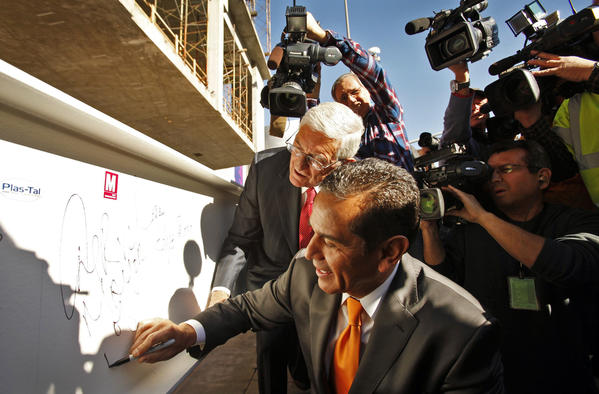 Eli Broad, in red tie, and Los Angeles Mayor Antonio Villaraigosa sign a beam that was to be placed atop the structure being built at Grand Avenue and 2nd Street. The Broad is scheduled to open in 2014.