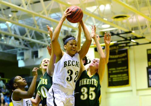 Bethlehem Catholic's Kalista Walters (32) pulls in a rebound against Central Catholic. At right is Central's Jackie Fronheiser. Central Catholic played at Bethlehem Catholic Tuesday night..