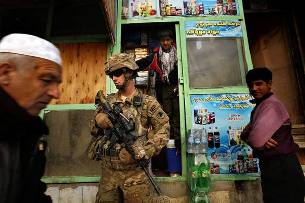 A U.S. soldier patrols downtown Kabul last month.