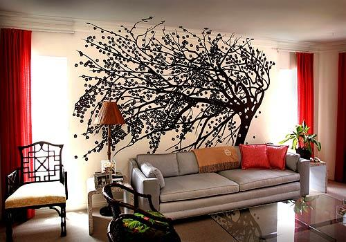 "A flowering quince tree painted by Jeff Robinson in the living room of Kate Schintzis is a mod take on the mural. Molly Luetkemeyer, who commissioned the work, calls such murals ""incredibly energizing."""
