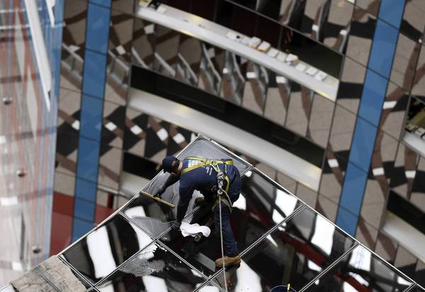 A window washer cleans the roof of a control room in the Thompson Center, which would look grand decked out with a Roman theme for a Chicago Way Casino.